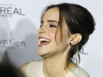 Honoree Emma Watson laughs as she is interviewed at the 19th Annual ELLE Women in Hollywood dinner in Beverly Hills