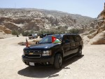 U.S. President Barack Obama's SUV is pictured against a rocky landscape in Petra
