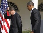 File photo of U.S. President Barack Obama walking off stage with Treasury Secretary Tim Geithner after speaking in the Rose Garden of the White House in Washington