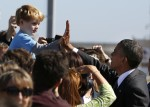 U.S. President Barack Obama high-fives with Max Frank, 4 years old, from Livermore after Obama arrives at San Francisco International Airport
