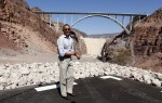 U.S. President Barack Obama gestures toward the Hoover Dam in Boulder City