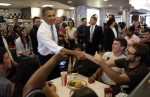 U.S. President Obama shakes hands at Sloopy's diner inside the student union of the Ohio State University in Cleveland