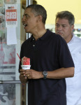 President Barack Obama holds his shave ice as he exits Island Snow to greet people waiting outside, Thursday, Jan. 3, 2013, in Kailua, Hawaii. President Obama and the first family are in Hawaii for ...