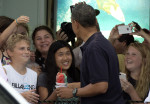 President Barack Obama holds his shave ice as he greets people outside Island Snow, Thursday, Jan. 3, 2013, in Kailua, Hawaii. President Obama and the first family are in Hawaii for a holiday ...