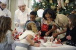 US first lady Michelle Obama works on decorations at the White House in Washington