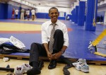 U.S. President Barack Obama puts on his shoes as he visits the U.S. Olympic Training Facility in Colorado Springs