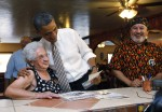 U.S. President Obama hugs Romero at a cafe in Pueblo