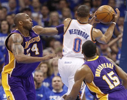 Los Angeles Lakers Guard Kobe Bryant, Left, Fouls Oklahoma City Thunder Guard Russell Westbrook (0) As Westbrook Shoots
