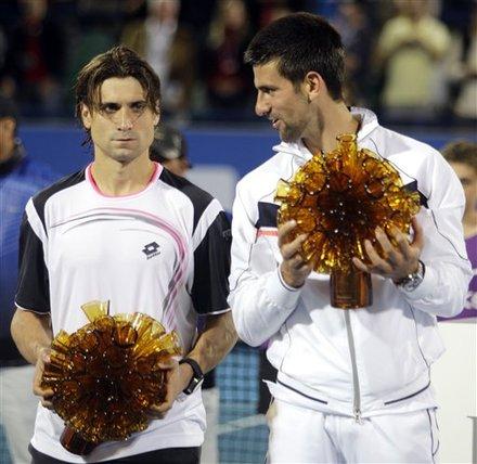 Serbia's Novak Djokovic, Right, Holds