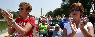 Jerri Pope (left) and Suzy Cox (right) cheer as Glenn Beck visits the site of the Restoring Honor rally in Washington, on Friday, Aug. 27, 2010. (AP/Jacquelyn Martin)