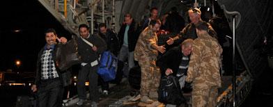 Cvilians disembark from a Royal Air Force C130 Hercules in Maltas. (Associated Press/Paul Randall)