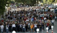 People hold a protest rally in Tbilisi September 19, 2012. REUTERS/David Mdzinarishvili