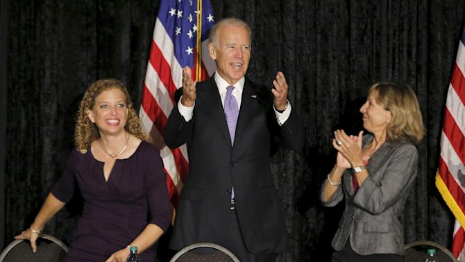 Joe Biden reacts upon arrival to meet with Jewish community leaders at the David Posnack Jewish Community Center in Davie