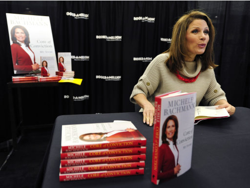 "Republican presidential candidate Rep. Michele Bachmann, R-Minn., talks during the book-signing event for her book ""Core of Conviction"" Saturday, Dec. 3, 2011, in Aiken, S.C.  (AP Photo/Rainier Ehrhardt)"
