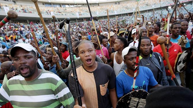 People gather to listen to the Zulu King's speech during a traditional gathering at the Moses Mabhida Football Stadium in Durban on April 20, 2015