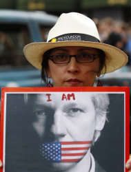 A supporter of WikiLeaks founder Julian Assange holds up a placard outside the Ecuadorian Embassy in central London, London, Thursday, Aug. 16, 2012. WikiLeaks founder Julian Assange entered the embassy in June in an attempt to gain political asylum to prevent him from being extradited to Sweden, where he faces allegations of sex crimes, which he denies. WikiLeaks chief Julian Assange was granted political asylum by Ecuador on Thursday, setting up a standoff with the British government, which has vowed to block his exit from the country. (AP Photo/Sang Tan)