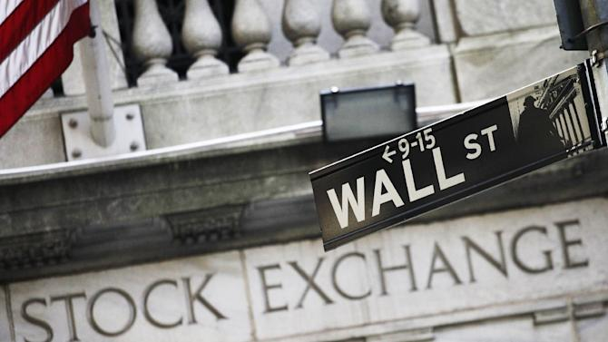 FILE - This July 16, 2013 file photo shows a Wall Street street sign outside the New York Stock Exchange in New York. Asian stocks erased gains and European markets were lower Thursday Sept. 11, 2014 as investors tried to second guess the Federal Reserve's thinking on the timing of an interest rate hike.  (AP Photo/Mark Lennihan, File)