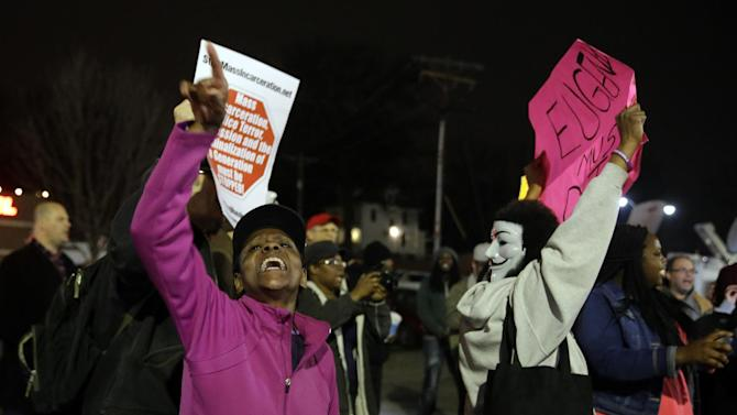 FILE - In this March 12, 2015 file photo, people demonstrate across the street from the Ferguson Police Department. Whites in the United States approve of police officers hitting people in far greater numbers than blacks and Hispanics do, at a time when the country is struggling to deal with police use of deadly force against men of color, according to a major American trend survey. (AP Photo/Jeff Roberson, File)