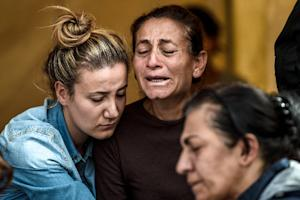A family mourns in an area allocated for families of …