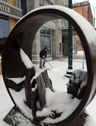 <p>               Micki DeCurtins shovels freshly fallen snow  outside of the Orpheum Theater off of Phillips Ave. in downtown Sioux Falls, S.D. on Thursday, Dec.27, 2012. (AP Photo/The Argus Leader, Jay Pickthorn)  NO SALES