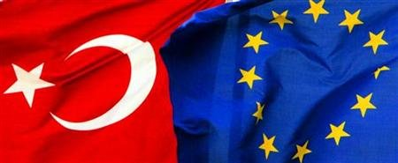 Flags of Turkey and the European Union are fluttered by the wind side by side in Istanbul in this file photo taken September 25, 2005. REUTERS/Fatih Saribas