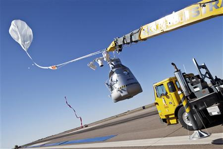 Handout photo of the crane launching the capsule carrying Felix Baumgartner during the final manned flight for Red Bull Stratos in Roswell