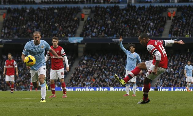 Arsenal's Theo Walcott shoots and scores his 2nd goal during their English Premier League soccer match against Manchester City at the Etihad stadium in Manchester
