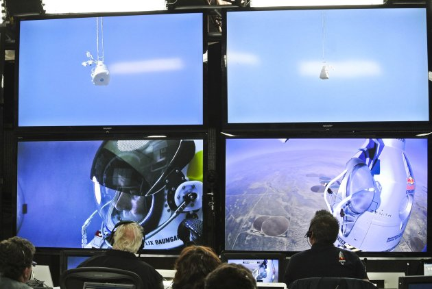 Handout photo of pilot Felix Baumgartner of Austria seen in the capsule on a screen at mission control center during the final manned flight for Red Bull Stratos in Roswell