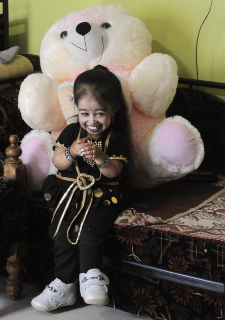 Indian Jyoti Amge, 18, who stands at 61.95 centimeters (2 feet), smiles as she prepares for a press conference with Guinness World Records in Nagpur, India, Friday, Dec. 16, 2011. Officials from Guinn