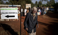 An elderly man leaves after casting his vote, while long lines of other waiting voters form outside, at the Mutumo primary school near Gatundu, north of Nairobi, in Kenya Monday, March 4, 2013. Multiple attacks against security forces in Kenya on Monday killed at least 12 people as Kenyans waited in long lines to cast ballots five years after more than 1,000 people died in election-related violence. (AP Photo/Ben Curtis)