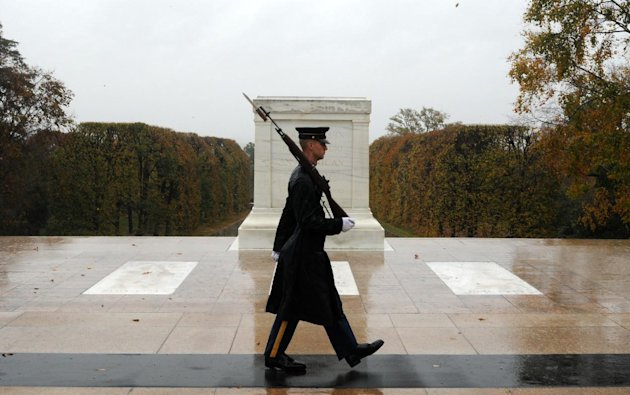 """This handout photo provided by the us Army shows Spc. Brett Hyde, Tomb Sentinel, 3d U.S. Infantry Regiment (The Old Guard), keeping guard over the Tomb of the Unknown Soldier during Hurricane Sandy, at Arlington National Cemetery, Va., Monday, Oct. 29, 2012. Just like the Sentinel's Creed says """"Through the years of diligence and praise and the discomfort of the elements, I will walk my tour in humble reverence to the best of my ability."""" (AP Photo/Sgt. Jose A. Torres Jr.,/U.S. Army Photo)"""