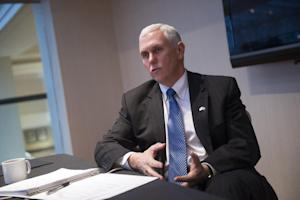 Indiana Mike Pence speaks with the Associated Press…