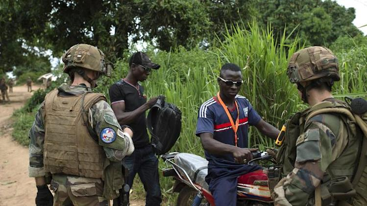 French soldiers from the 13th Alpine Hunters Battalion (13th BCA) control anti-balaka members as they patrol near the northwestern Central African Republic city of Boda on April 7, 2014