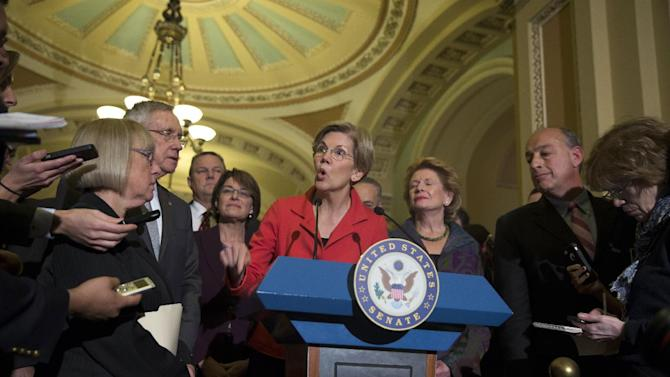 Sen. Elizabeth Warren, D-Mass., speaks during a news conference on Capitol Hill in Washington, Thursday, Nov. 13, 2014, after Senate Democrats voted on leadership positions for the 114th Congress. From left are, Sen. Patty Murray, D-Wash., Senate Majority Leader Harry Reid of Nev., Sen. Jon Tester, D-Mont., Sen. Amy Klobuchar, D-Minn., Warren, Sen. Charles Schumer, D-N.Y., and Sen. Debbie Stabenow, D-Mich.    (AP Photo/Evan Vucci)