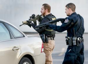 Police look for a possible second shooter in the parking…