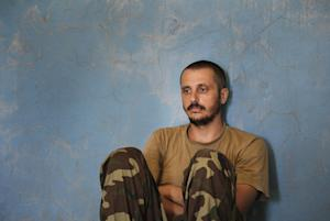 A captured Ukrainian border guard sits in a garage …