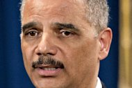 "Attorney General Eric Holder is questioned about the Justice Department secretly obtaining two months of telephone records of reporters and editors for The Associated Press, during a news conference at the Justice Department in Washington, Tuesday, May 14, 2013. In what the news cooperative's top executive called a ""massive and unprecedented intrusion,"" the Justice Department monitored outgoing calls for the work and personal phone numbers of individual reporters, for general AP office numbers in New York, Washington and Hartford, Conn., and for the main number for the AP in the House of Representatives press gallery, according to attorneys for the AP. (AP Photo/J. Scott Applewhite)"