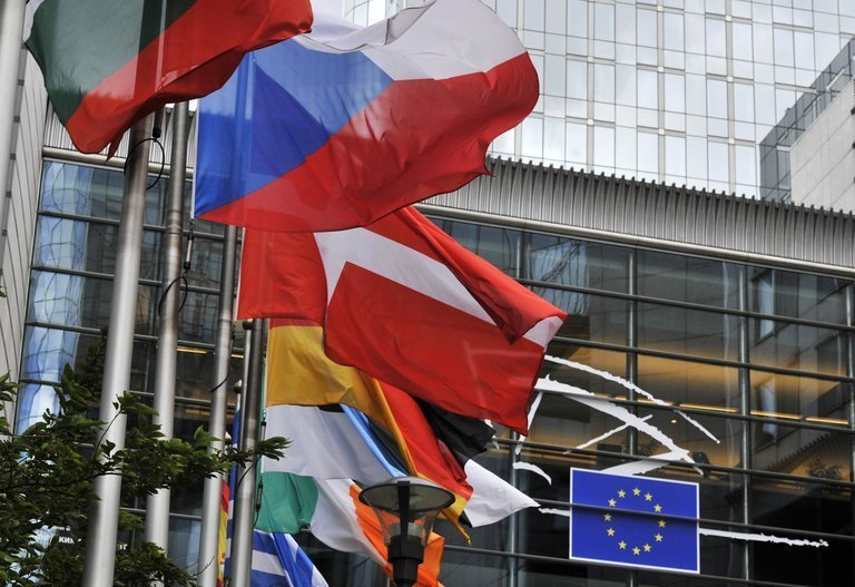 Flags of the EU member states fly in front of the European Parliament in Brussels on July 19, 2012
