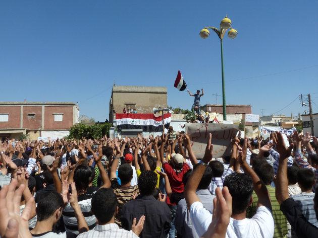 Demonstrators protesting against Syria's President Bashar al-Assad gather in Hula