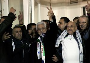 Palestinian President Mahmoud Abbas, center, receives …