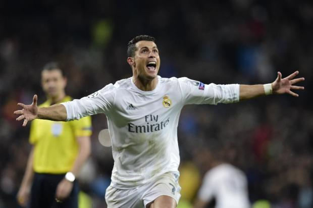 Real Madrid forward Cristiano Ronaldo celebrates scoring a hat-trick against Wolfsburg in the Champions League quarter-final in Madrid on April 12, 2016