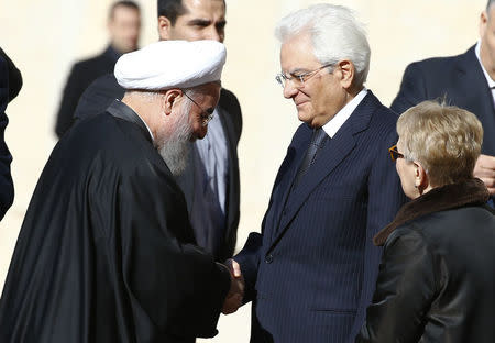 Iran President Rouhani shakes hands with Italian President Mattarella at the Quirinale presidential palace in Rome