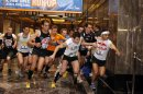FILE- In this Feb. 8, 2012 file photo, six-time champion Thomas Dold (1), of Germany, leads the men's elite field at the start of the 35th Annual Empire State Building Run-Up, at the Empire State Building in New York. Contestants from around the world will compete in the event on Wednesday, Feb. 6, 2013. (AP Photo/Jason DeCrow, File)