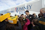 Republican vice presidential candidate, Rep. Paul Ryan, R-Wis., talks to his daughter Liza at a tailgate party for the football game between the Green Bay Packers and the Arizona Cardinals at Lambeau Field, Sunday, Nov. 4, 2012 in Green Bay , Wis. (AP Photo/Mary Altaffer)