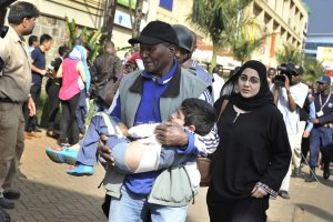 A rescue worker helps a child outside the Westgate…