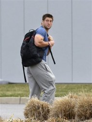FILE - In this Monday, April 15, 2013 file photo, New York Jets quarterback Tim Tebow arrives on the first day of NFL football offseason workouts at the Jets practice facility in Florham Park, N.J. The New York Jets say, Monday, April 29, 2013, they have waived Tim Tebow. (AP Photo/Mel Evans, File)