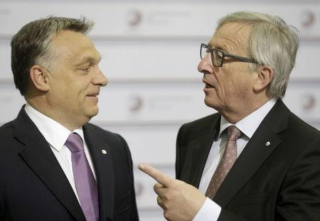 European Commission President Juncker speaks to Hungary's Prime Minister Orban before the Eastern Partnership Summit session in Riga
