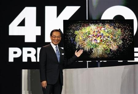 """Panasonic chief Kazuhiro Tsuga introduces the company's new 4K OLED 56"""" television during the Panasonic opening day keynote at the Consumer Electronics Show (CES) in Las Vegas January 8, 2013. REUTERS/Rick Wilking"""