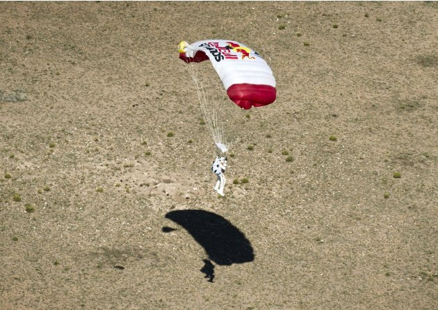 Handout photo of pilot Felix Baumgartner of Austria landing in the desert after completing the final manned flight for Red Bull Stratos in Roswell