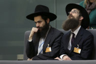 Orthodox Jews attend a meeting of the German Federal Parliament, Bundestag, in Berlin, Germany, Wednesday, Dec. 12, 2012. The German Parliament is expected to vote on legislation clarifying the legality of infant male circumcision for religious reasons. The government drew up the legislation after a court in June ruled the practice could amount to criminal bodily harm — prompting outrage in Germany's Jewish and Muslim communities. (AP Photo/Michael Sohn)
